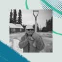 winter keeper outside shoveling snow