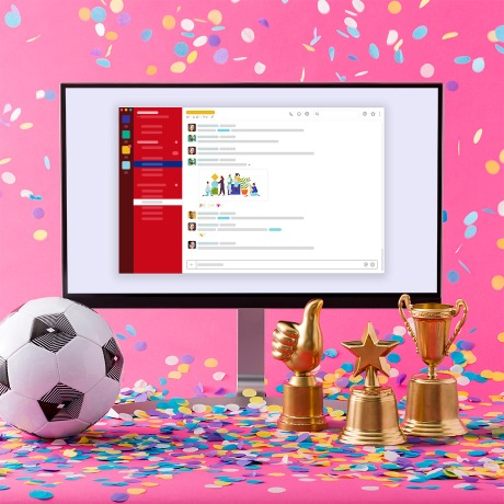 A soccer ball, confetti, and a monitor for a World Cup celebration