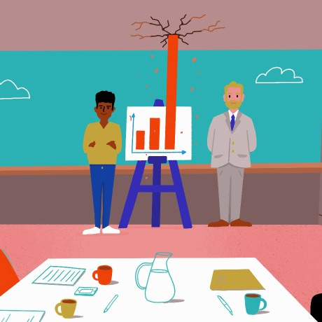performance goals hero image of two people presenting charts during a meeting
