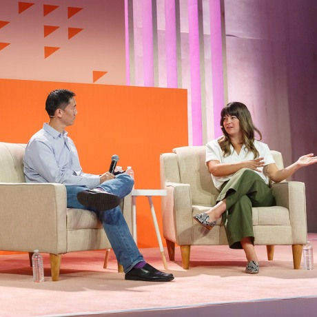 Slack's VP of People Robby Kwok on stage at Frontiers (Slack's annual conference) with Kaitlin Norris, culture specialist at Shopify, discussing how they use Slack for everything from recruiting new hires to maintaining employee engagement.