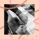 A SingleThread restaurant employee checks her Slack messages on a smartwatch.