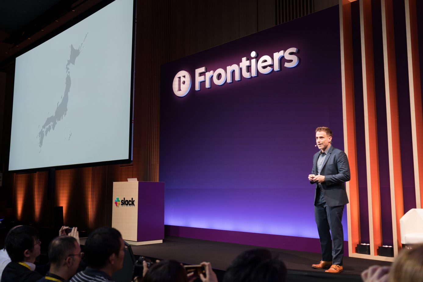 Slack founder and CEO Stewart Butterfield addresses attendees from the stage at Frontiers Tokyo.