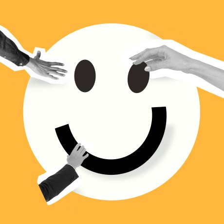 employee happiness hero hands putting a happy face together